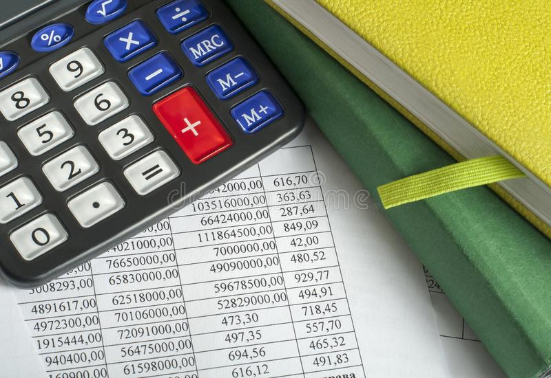 Financial and budget concept. Calculator, accounting books and financial documents on office table royalty free stock image