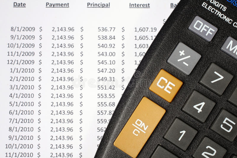 Download Calculator And Amortization Table Stock Photo - Image: 12589498