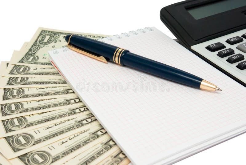 Calculator, blocnote en geld stock foto