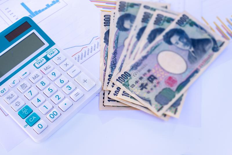 Calculator With Blurred Japanese Currency Yen Bank Notes And