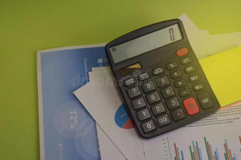 Calculator budget cost and analysis financial and paperwork. Business and finance concept of office desk royalty free stock images