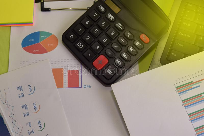 Calculator budget cost and analysis financial and paperwork. Business and finance concept of office desk stock photos