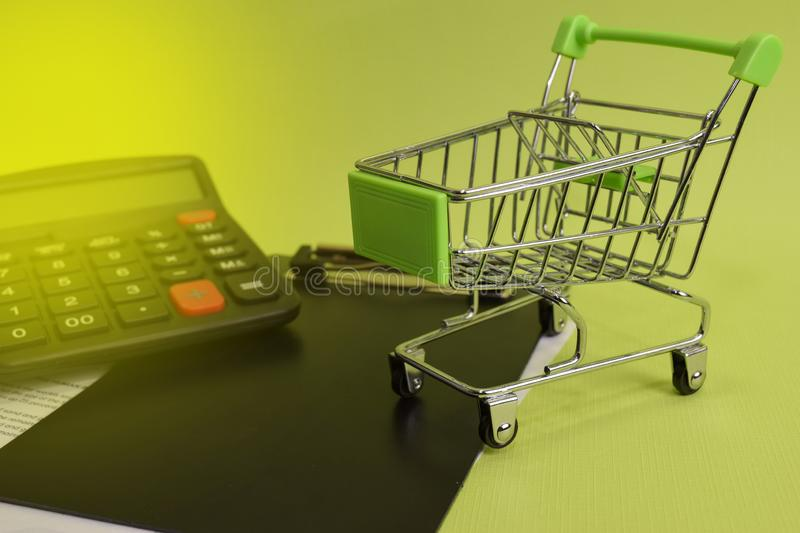 Calculator budget cost and analysis financial. Selective focus on shopping cart. Business and finance concept of office desk royalty free stock photos