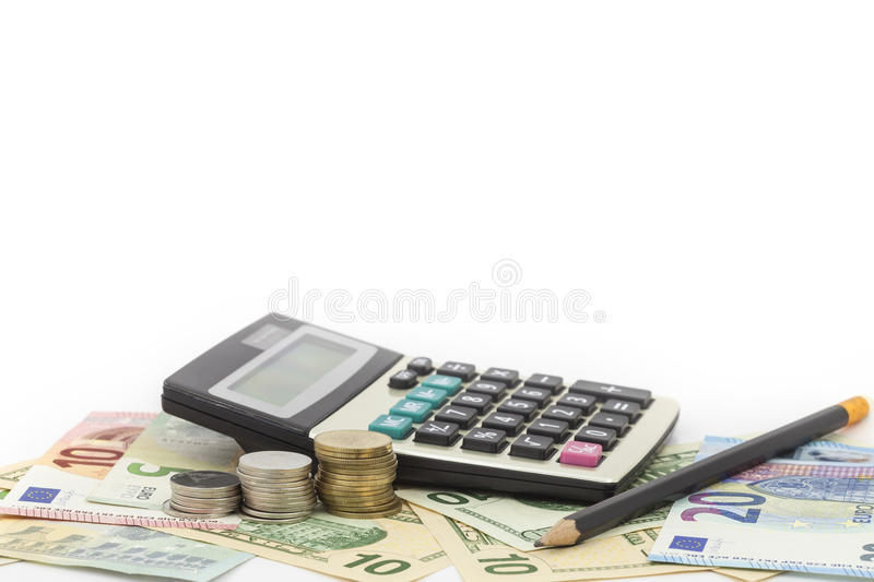 Calculator with coin ,pencil on money banknotes Euro and Dollars stock photo