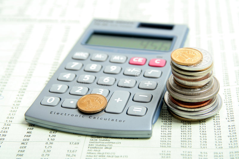 Calculator and Coins. On Financial Paper stock photo