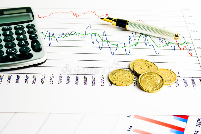 Calculator and coins on financial chart. Detail of calculator and coins on financial chart royalty free stock photos