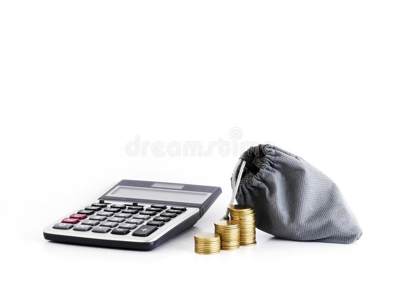 Calculator and coins with money bag for loans concept. Calculator and coins with money bag for finance loans concept stock photo