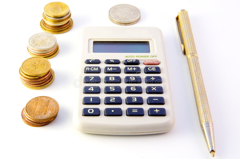 Calculator, coins and pen. Isolated on white background royalty free stock images
