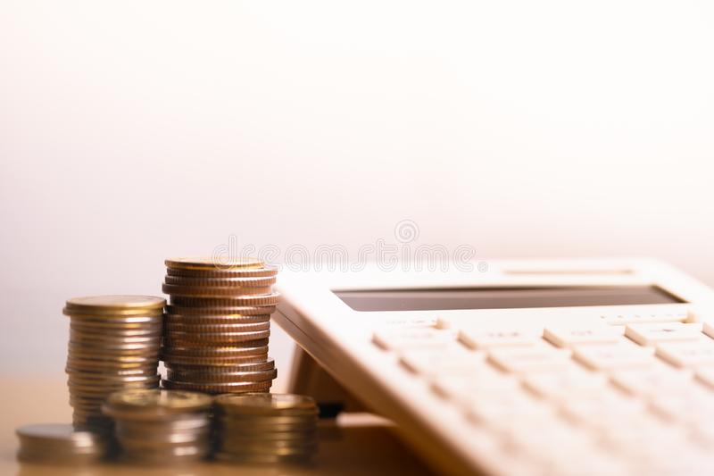 Calculator and coins stack. Retirement planning. Investment and money saving royalty free stock photos