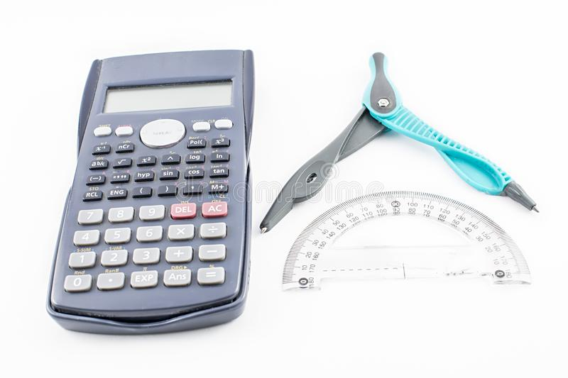 Calculator, conveyor and compass. royalty free stock images