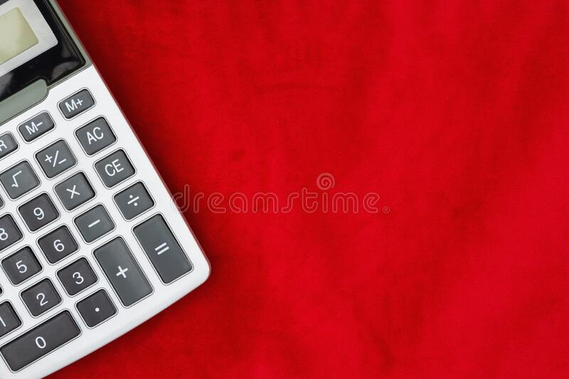 Calculator with a display on red royalty free stock image