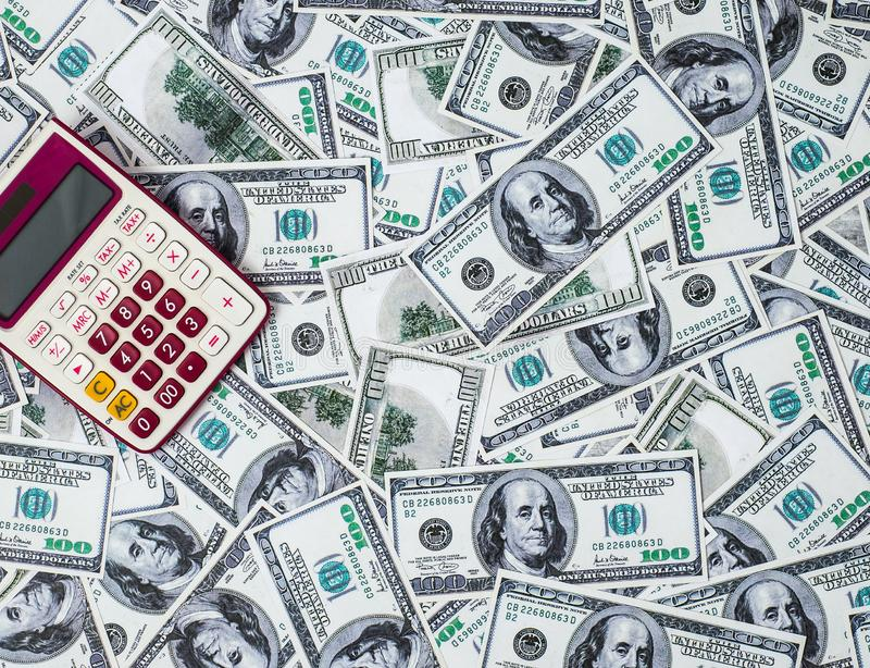 Calculator and 100 dollars royalty free stock images