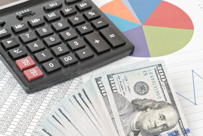 Calculator en dollarspak stock foto's
