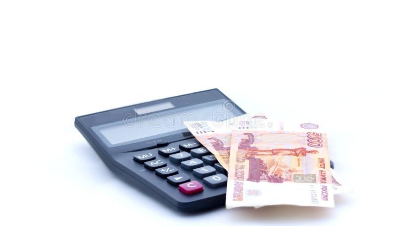 Calculator en Russische bankbiljetten op witte achtergrond royalty-vrije stock foto's