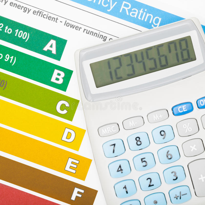 Calculator and energy efficiency chart royalty free stock photography