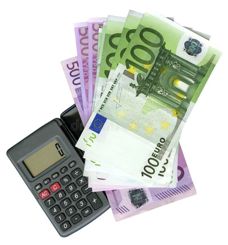 Calculator with Euro bank notes royalty free stock photos