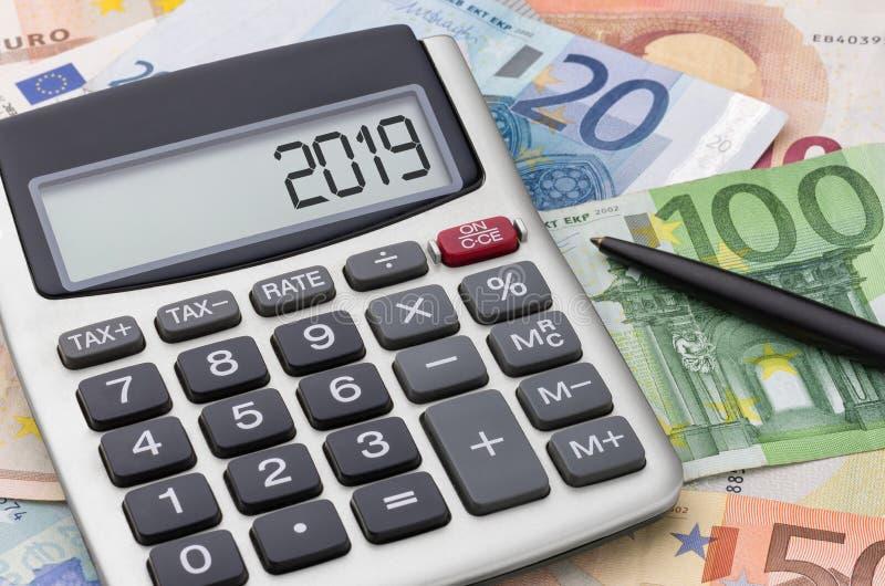 Calculator with Euro bills - 2019 stock photos