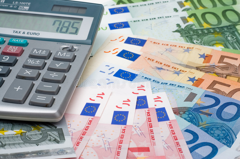 The calculator and the euros. The calculator and the many euros stock photography