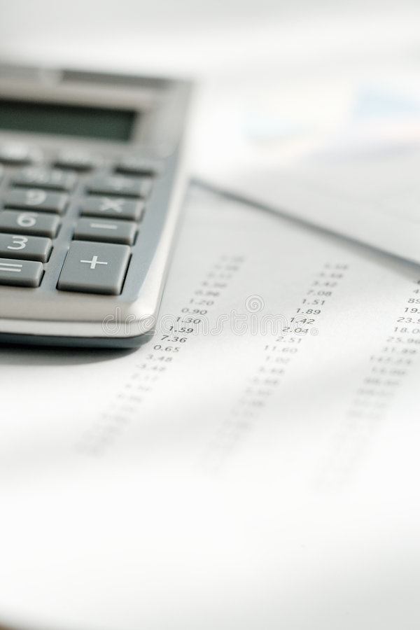 Calculator And Figures Royalty Free Stock Image