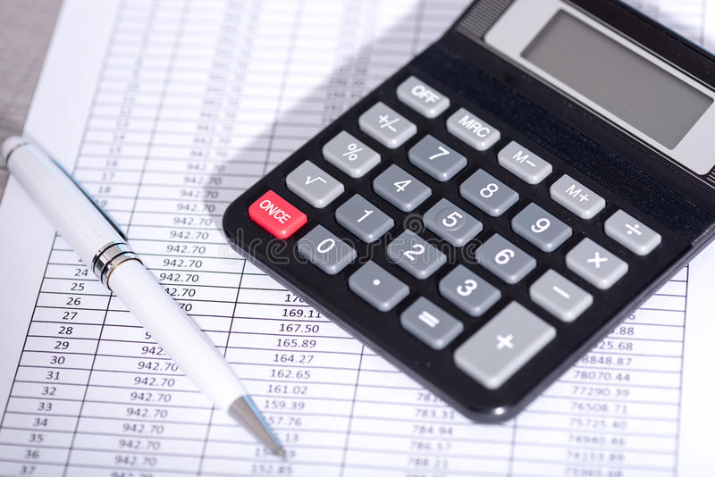Calculator on financial documents, accounting concept royalty free stock images