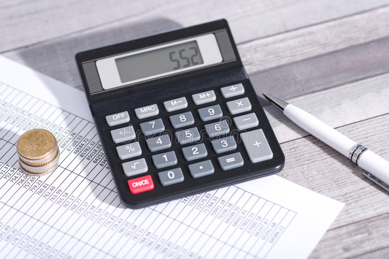 Calculator on financial documents, accounting concept stock photo