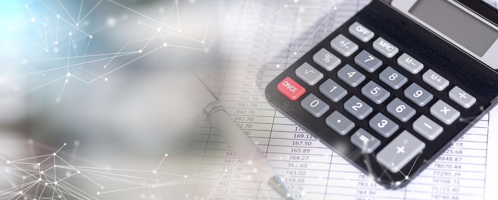 Calculator on financial documents, accounting concept; multiple exposure royalty free stock photos