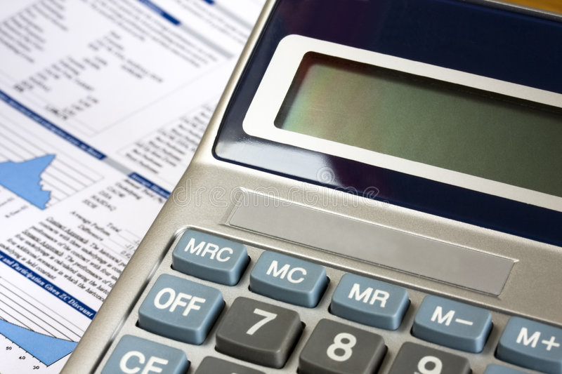 Calculator and financial report as background.