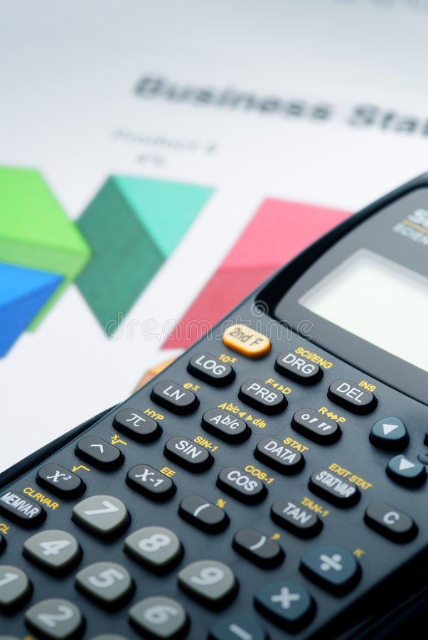 Calculator on the Graph. Calculator on the Business papers with Graph royalty free stock image
