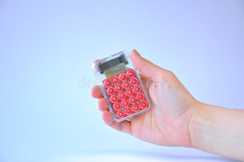 Calculator in hand stock images