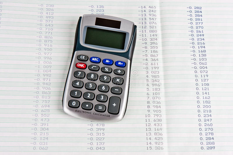Download Calculator With A Hard Copy Of Tabular Digits Stock Illustration - Image: 21526765