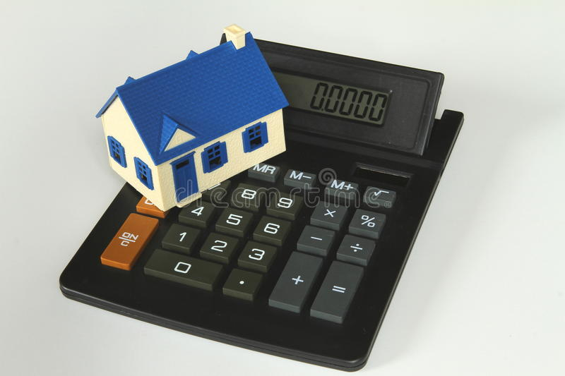 Calculator with house stock image