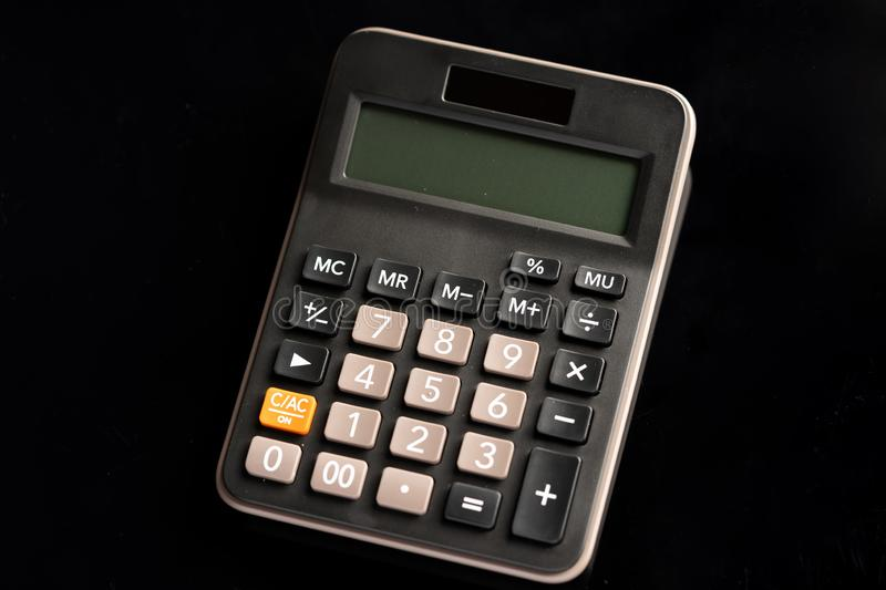 Calculator isolated on black background stock photography