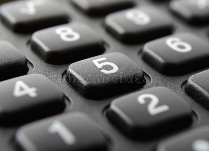 Calculator keypad close up. Calculator keypad with white digits close up stock image