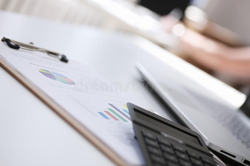 Calculator lie on paper document diagram royalty free stock image