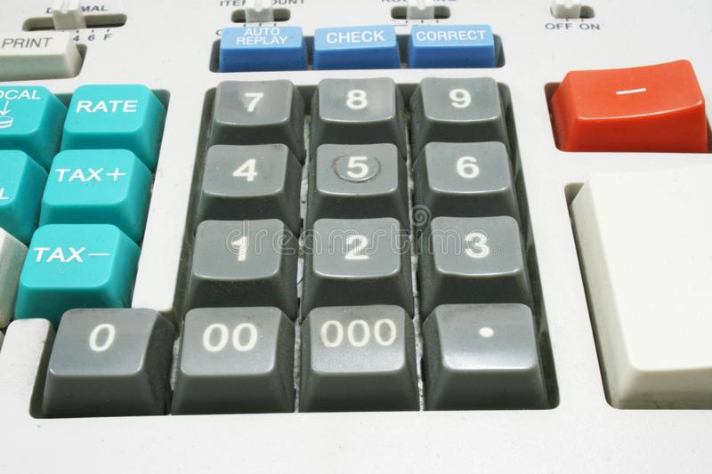 Calculator machine for income tax return. Analyzing tool royalty free stock photography