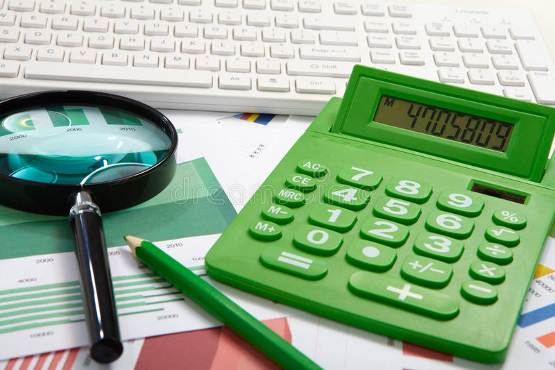 Calculator and magnifier royalty free stock image