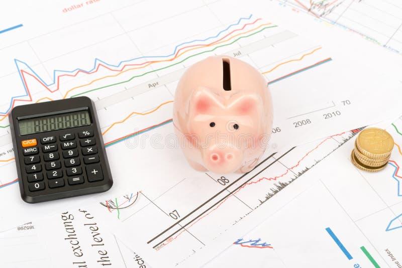 Calculator met Spaarvarken royalty-vrije stock afbeeldingen