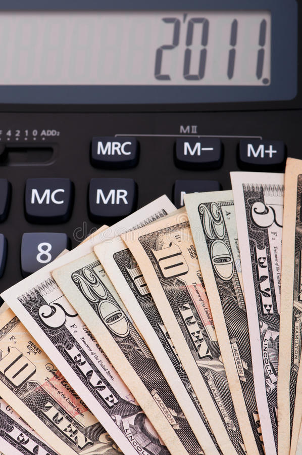 Calculator and money. Of $5-$20 banknotes. 2011 happy new year royalty free stock images