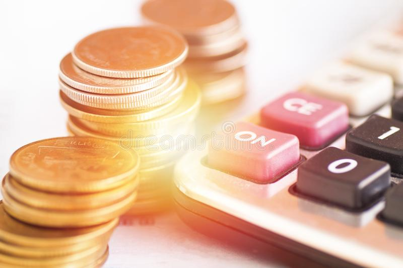 Calculator and money coins, concept in growth, save and investment. In business stock image