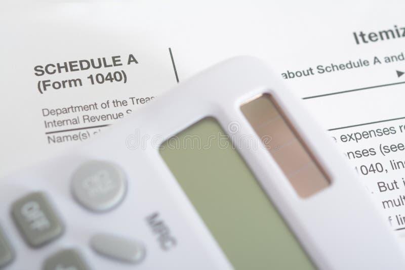 Calculator. A new White Calculator and tax report stock photo