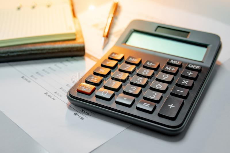 Calculator, notebook, pen and summary report paper royalty free stock photos