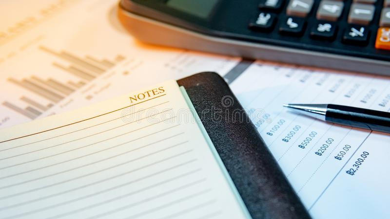 Calculator, notebook, pen and summary report paper stock photo
