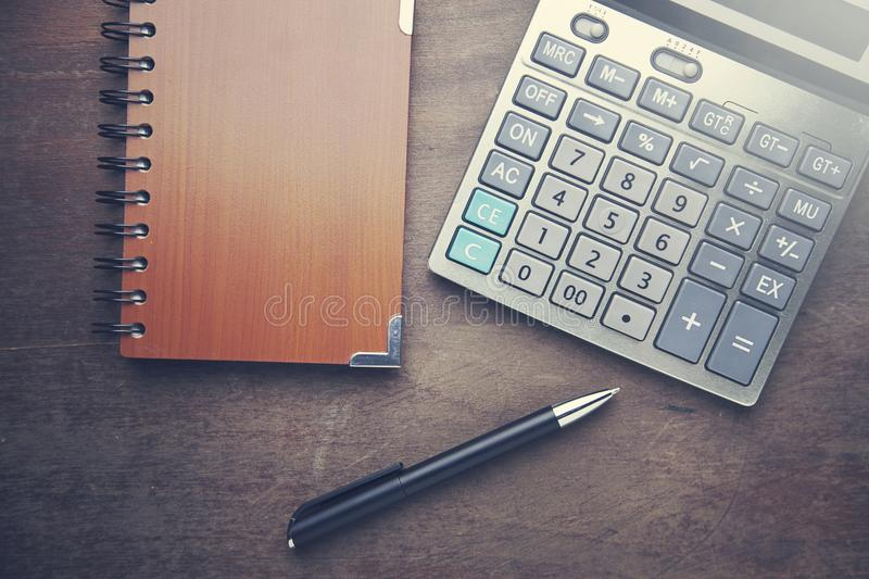 Calculator with notebook and pen stock images