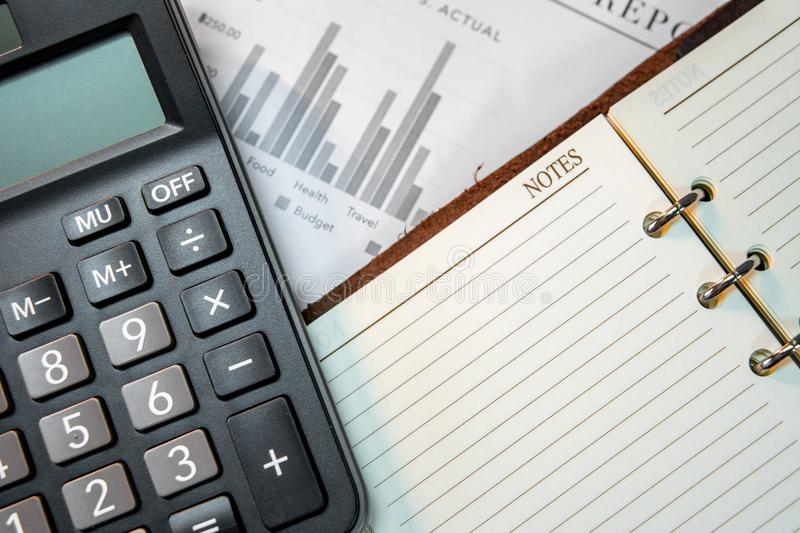 Calculator, notebook and summary report paper stock images