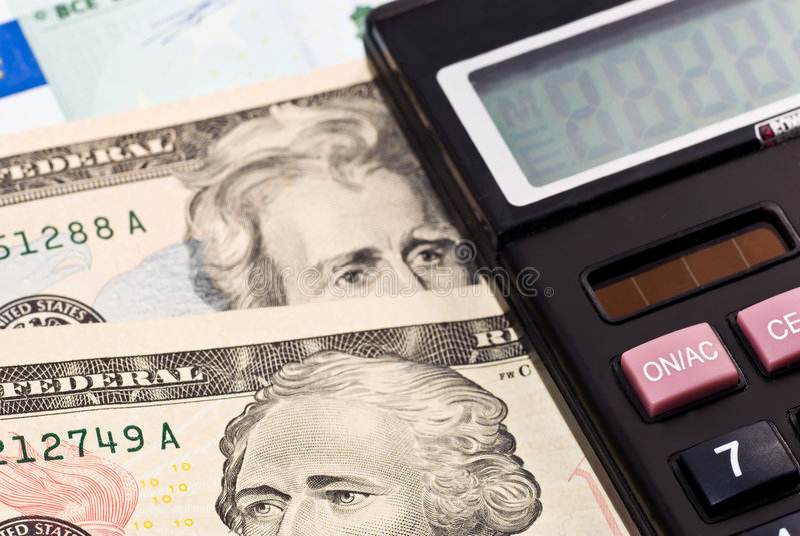 Calculator over money royalty free stock photo