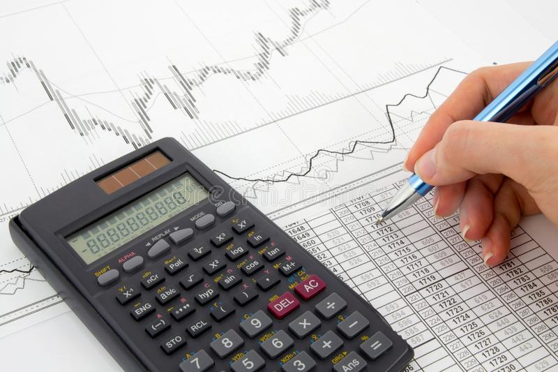 Calculator And Pen On A Business Background Royalty Free Stock Images