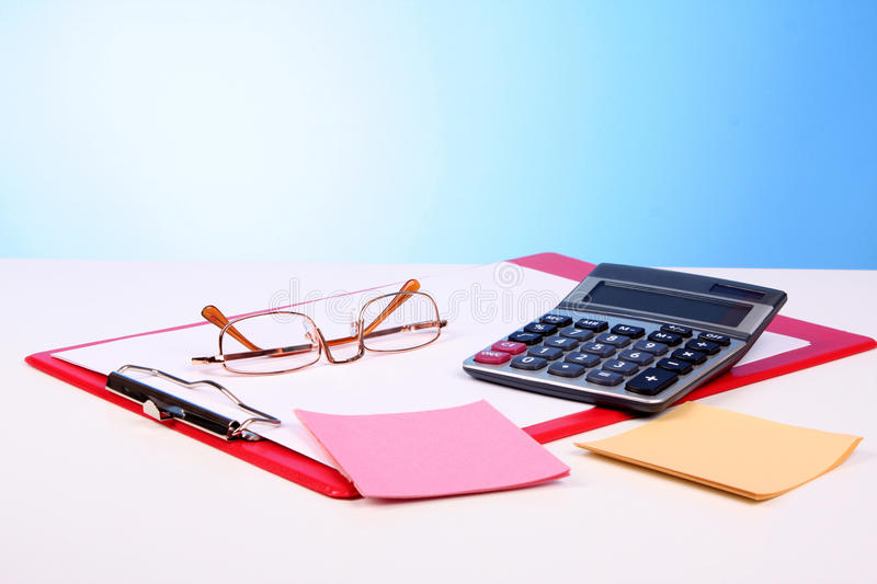 Calculator, pen and charts. On the table stock photo