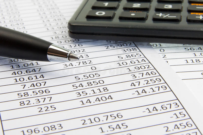 Calculator And Pen On Financial Papers Stock Photos