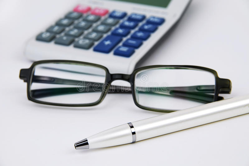 Calculator pen and glasses royalty free stock image