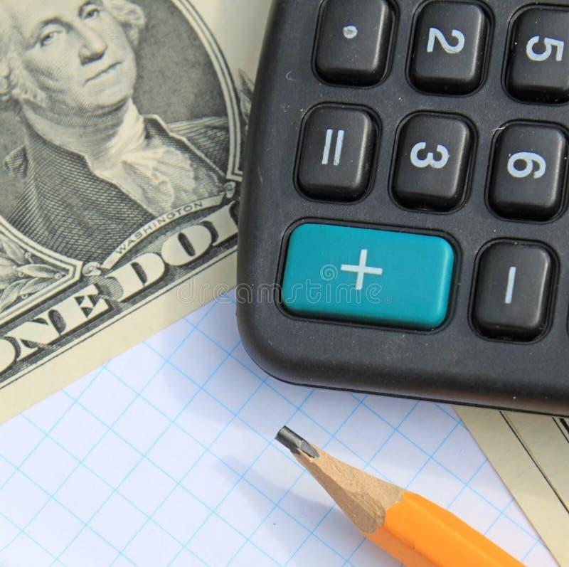 Calculator, Pen And Pad At Dollars Stock Photo